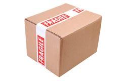 Caja de cartón y cinta frágil Fotos de archivo libres de regalías