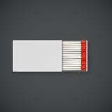 Caja de cerillos con la cabeza roja Fotos de archivo libres de regalías