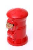 Caja de dinero de los posts con la moneda Imágenes de archivo libres de regalías