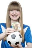 Caja de dinero del fútbol de las muchachas Imagenes de archivo