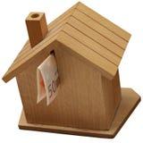 Caja de dinero, hucha en una casa de madera Fotos de archivo