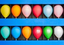 Caja de globos Imagenes de archivo
