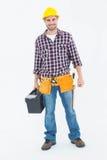 Caja de herramientas que lleva del hanyman masculino feliz Foto de archivo libre de regalías