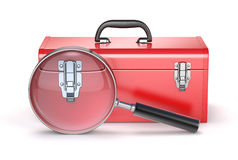Caja de herramientas roja con la lupa Fotografía de archivo libre de regalías