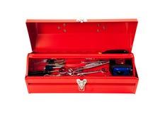 Caja de herramientas roja del metal con las herramientas en blanco Fotos de archivo