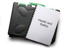 Caja de herramientas y cuaderno negros Foto de archivo