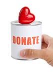 Caja de la donación y corazón rojo Fotografía de archivo