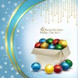 Caja de la Navidad con las bolas coloreadas Foto de archivo libre de regalías