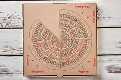 Caja de la pizza en el contexto de madera Imagen de archivo