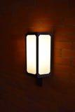 Caja de luz en la pared de ladrillo Foto de archivo libre de regalías