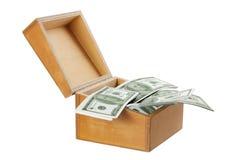 Caja de madera con el dinero Imagen de archivo libre de regalías