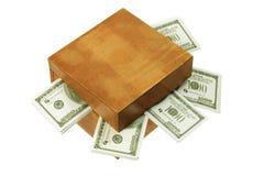 Caja de madera con el dinero Imágenes de archivo libres de regalías