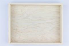 Caja de madera en blanco en el fondo blanco Fotos de archivo libres de regalías