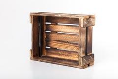 Caja de madera quemada hecha a mano en un fondo ligero Imagen de archivo