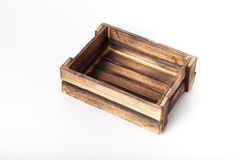 Caja de madera quemada hecha a mano en un fondo ligero Imagenes de archivo
