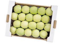 Caja de manzanas amarillas verdes 'golden delicious' Fotos de archivo