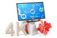 Caja de regalo con el aparato de TV 4K o el monitor de computadora 4k, representación 3D Fotos de archivo