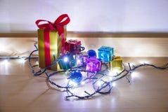 Caja de regalo de la iluminación Fotografía de archivo