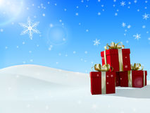 Caja de regalo de la Navidad en nieve Fotos de archivo