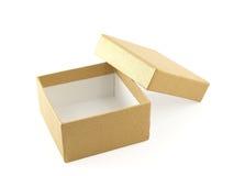 Caja de regalo de oro abierta y vacía Fotos de archivo