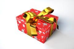 Caja de regalo roja con comienzo de oro y una cinta. Foto de archivo