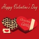 Caja del día de tarjeta del día de San Valentín de fondo del rojo del caramelo de chocolate y de la tarjeta de felicitación Fotos de archivo libres de regalías