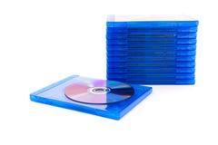 Caja del DVD con el disco fotografía de archivo libre de regalías