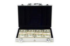 Caja del metal y porciones de dólares Fotos de archivo libres de regalías