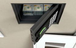 Caja fuerte y billetes de banco abiertos de la pared foto de archivo libre de regalías