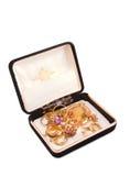 Caja negra del vintage con las joyas Imagen de archivo libre de regalías