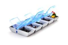 caja para pescar los accesorios en el fondo blanco imagen de archivo libre de regalías