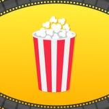 Caja redonda de las palomitas Marco redondeado tira de la película Icono del cine de la película El hacer estallar de la palomita Foto de archivo
