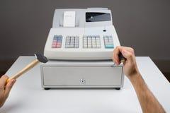 Caja registradora de Person Hands With Worktool And Imagen de archivo