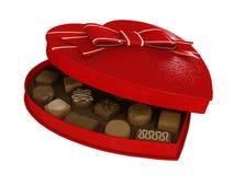 Caja roja de los chocolates del caramelo del corazón Imagen de archivo libre de regalías