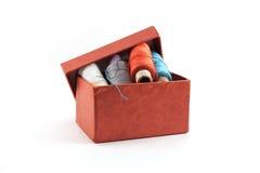 Caja roja para el hilo Imágenes de archivo libres de regalías