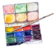 Caja y cepillo de la pintura del color de agua Imagen de archivo libre de regalías