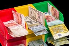 Cajas con tres tipos de moneda Imagen de archivo libre de regalías