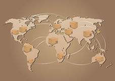 Cajas de cartón en fondo del mapa del mundo Foto de archivo