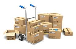Cajas de cartón y carro de mano Imágenes de archivo libres de regalías