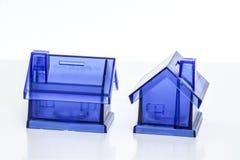 Cajas de dinero azules - casa Imagen de archivo libre de regalías