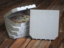 Cajas de la pizza en tablones de madera del vintage Mofa para arriba imagen de archivo libre de regalías
