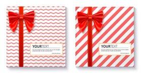 Cajas de regalo con el arco y la cinta rojos grandes en el fondo blanco Imagen de archivo libre de regalías