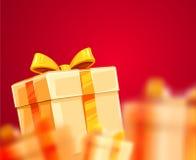 Cajas de regalo de vacaciones de la Navidad que embalan con la cinta Fotografía de archivo