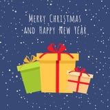 Cajas de regalo envueltas coloridas con vector de los copos de nieve Imágenes de archivo libres de regalías