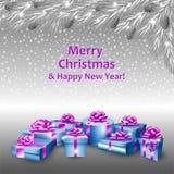 Cajas de regalo y un árbol de navidad Fotografía de archivo libre de regalías