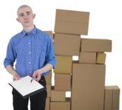 Cajas del hombre y de cartón de la pila Imagen de archivo