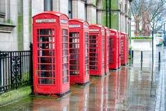 Cajas del teléfono en la lluvia Imagen de archivo libre de regalías