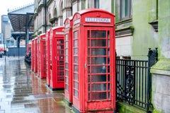 Cajas del teléfono en la lluvia Imágenes de archivo libres de regalías