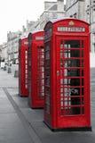 Cajas del teléfono en la milla real Fotografía de archivo