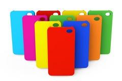 Cajas plásticas multicoloras del teléfono móvil Fotografía de archivo